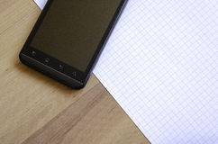 Phone and notepad Stock Photo