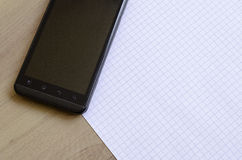 Phone and notepad Royalty Free Stock Images