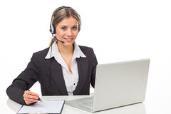 Phone operator with headphones and laptop Stock Photography