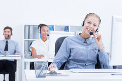 Phone operator in light office Royalty Free Stock Photos