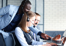 Phone operator working at call centre Stock Image