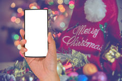 Phone with ornaments in Christmas time . Royalty Free Stock Photo