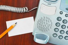 Phone, paper card and pencil Royalty Free Stock Photo