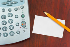 Phone, paper card and pencil Stock Photography