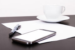 Phone, Paper and Coffee Royalty Free Stock Photography