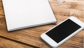 Phone and papper stock image