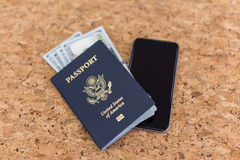 Phone and passport on table Stock Photo