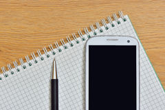 Phone pen and Notepad Stock Photography