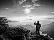 Phone photographer takes picture of freeze hilly landscape Royalty Free Stock Photography