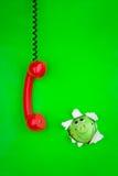 Phone and piggy bank Stock Photos