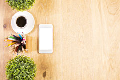 Phone, plants and pencils Royalty Free Stock Images