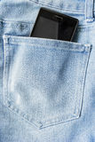 Phone in a pocket Stock Photo