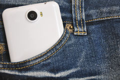 Phone is in the pocket of jeans. Royalty Free Stock Photo