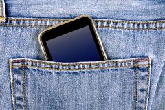 Phone in the Pocket. Mobile Phone in the Jeans Pocket closeup royalty free stock photo