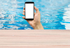 Phone in a pool Royalty Free Stock Photos