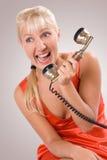 Phone quarrel. #1. Girl in red. Phone quarrel. #1 stock photos