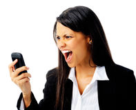 Phone rage. Woman has an angry emotion reaction while screaming at her cell phone Stock Photography