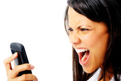 Phone rage. Woman has an angry emotion reaction while screaming at her cell phone Royalty Free Stock Photos