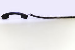 Phone receiver with a long cord Stock Image