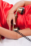 Phone receiver and woman in red. #3. Retro phone receiver in woman hands. #3 stock photography