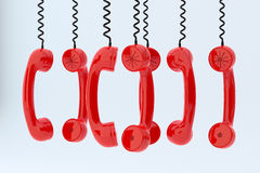 Phone receivers hanging. 3d render of red phone receivers hanging Royalty Free Stock Photography