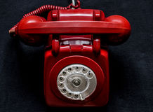 Phone. Red retro phone on a black background Stock Photography