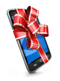 Phone and red ribbon gift Royalty Free Stock Image