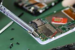 Phone repair chip Stock Images