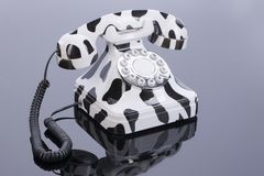 Phone In Retro Style. On a glass studio background stock photos