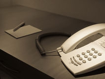 Phone on the room desk Royalty Free Stock Photos