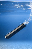Phone into sea royalty free stock image