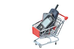 Phone in shopping basket Stock Photo