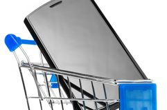Phone in shopping cart Stock Image