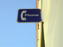 Phone Sign. Sign at a suburban strip mall, indicating the location of a public phone Royalty Free Stock Images
