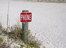 Phone sign. A Phone sign in the sand at a beach, near the ocean Stock Photo