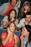 Phone Silence In Theater. Loud women on phone annoys people in theater Stock Photo