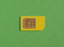 Phone sim card over green with copy space Stock Image