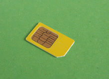 Phone sim card over green with copy space Royalty Free Stock Photo
