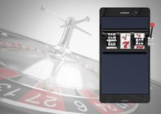 Phone with slot machine and roulette background. Digital composite of Phone with slot machine and roulette background Royalty Free Stock Photo