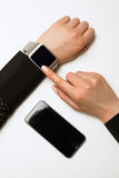 Phone and smart watch on a female hand stock images