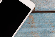 Phone smartphone close-up on a blue wooden background Stock Photo