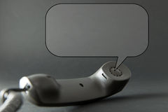 Phone with speech bubble Royalty Free Stock Image