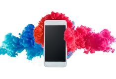 Phone in splash ink color mix in water. Phone in abstract splash ink color mix in water stock photos
