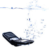Phone splashing into water - high key Stock Image