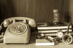 Phone and stationery with a vintage. Stock Photos