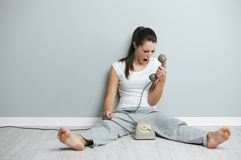 At the phone Stock Image