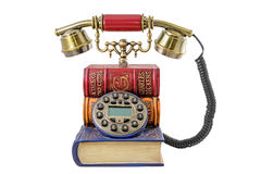 Phone stylized under a pile of books Stock Image