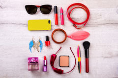 Phone, sunglasses and cosmetics. Royalty Free Stock Image
