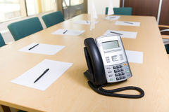 Phone on table in meeting room Stock Photo