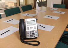 Phone on table in meeting room Royalty Free Stock Photos